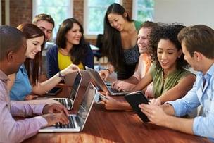 diverse_people_around_desk.jpg