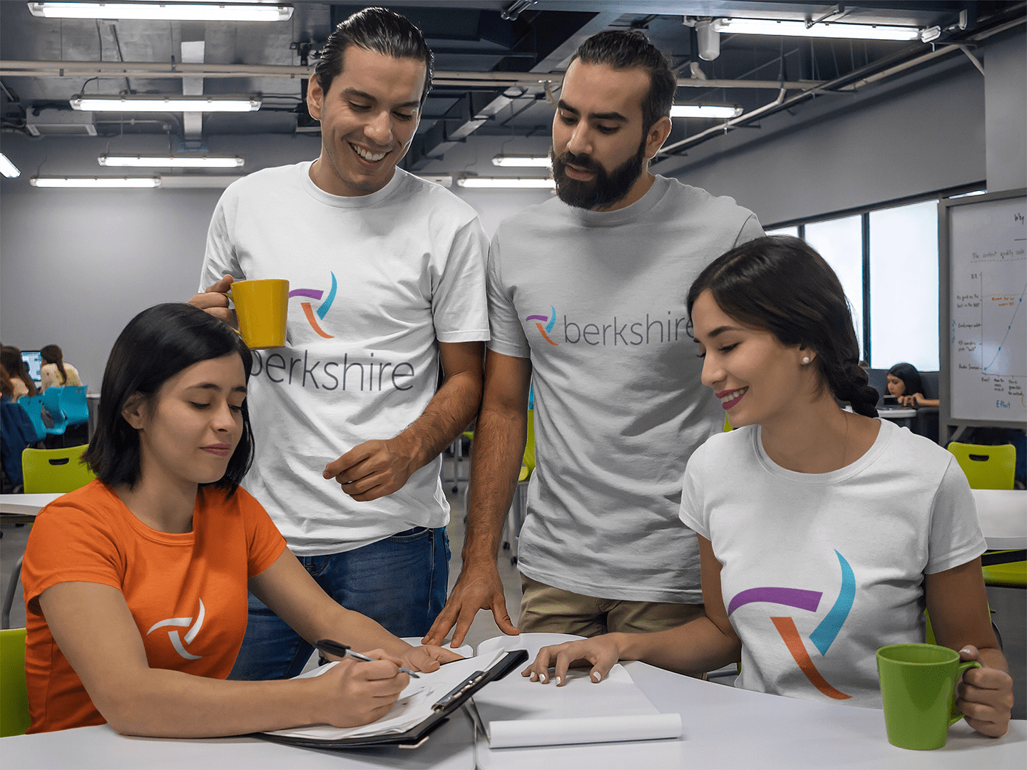group-of-four-coworkers-talking-while-wearing-different-tshirts-mockup-a15650